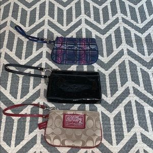 coach wristlets (come in set of 3)
